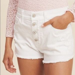 White Hollister high-waisted shorts distressed hem